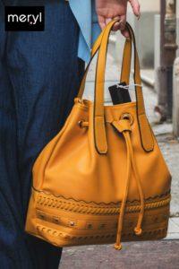 borsa ecopelle con borchie